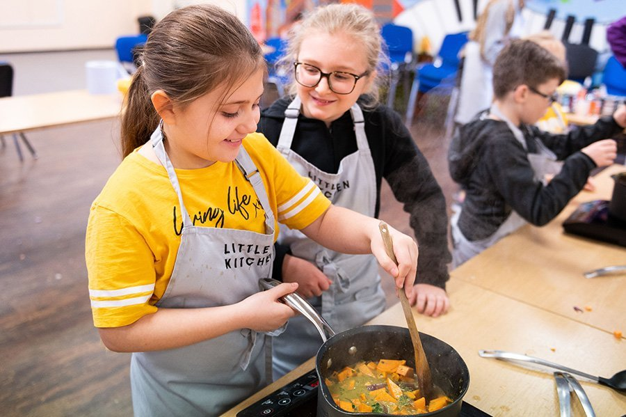 Young people learning to cook during Break Free